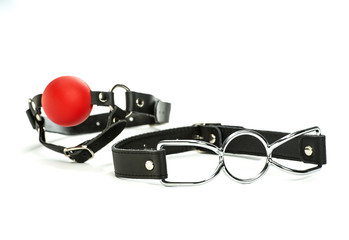 toys for bondage: spider-gag and red ball-gag