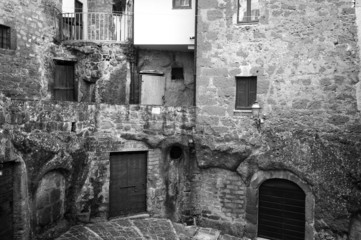 Pitigliano, Tuscany, old city center view. BW image