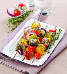 vegetable skewers with dry grasses