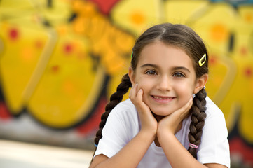 Smiling Cute Little Girl with Hands on Face