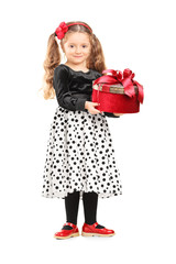 Cute little girl holding a present