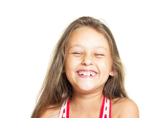 Cute little girl having fun laughing on a white background isola