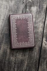 Old notebook on old wooden background