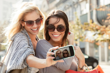Beautiful blonde and brunette taking a selfie