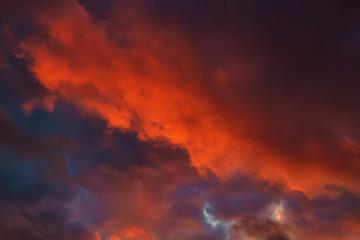 Dark cloudy dramatic sky in sunset.