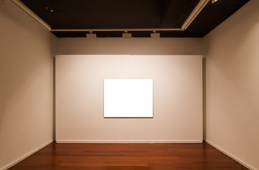 Art gallery interior with blank picture on the wall.
