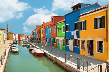 colorful houses by the water canal at the island Burano Venice