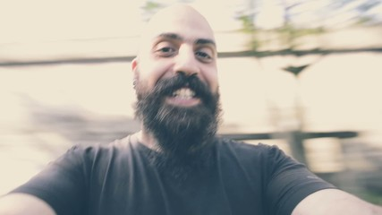 bearded man playing around smiling movement joy