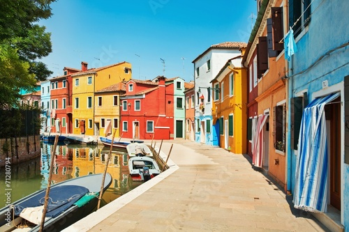Fotobehang Venice colorful houses by the water canal at the island Burano Venice