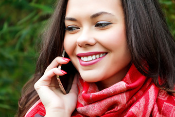 Woman talking by mobile phone