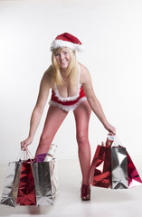 A sexy female Santa holding Christmas shopping