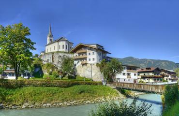 Salzach river flowing through the city Kaprun, Austria.