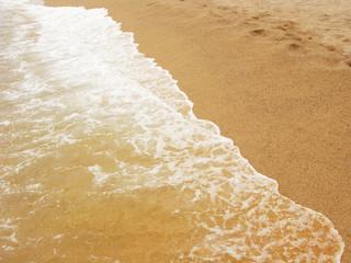Foamy shoreline in Costa Brava beach at summer