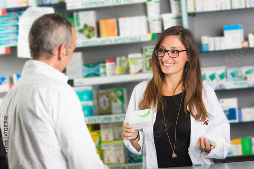 Pharmacist and Client in a Drugstore - 71281946