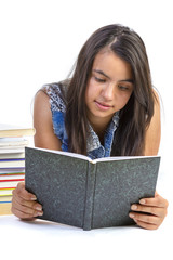 Girl teenager reading book over white background