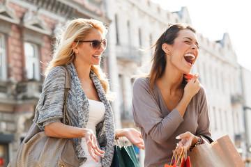 Two Women Enjoying. Selective focus on brunette.