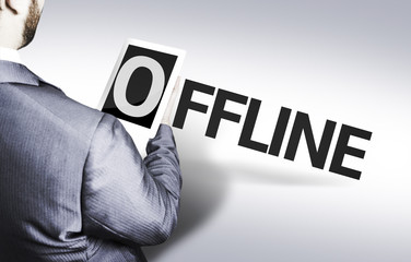 Business man with the text Offline in a concept image