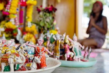 Woman praying in a Hindu shrine