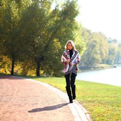 Young woman walking on a beautiful fall day