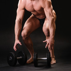 muscular bodybuilder with dumbbell