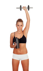 Woman after her training, drinking protein shake and with an app