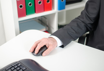 Businessman holding a computer mouse
