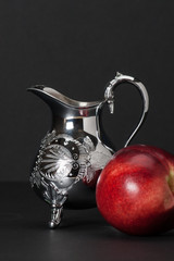 Nectarine. Old Silver Pitcher With Decorative Stamping Pattern