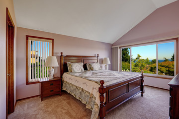 Master bedroom interior in light pink color with scenic windown