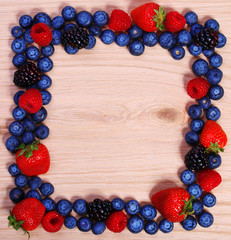 Berries Frame on Wooden Background. Strawberries, Blueberry