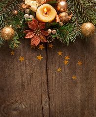 Christmas border on on wooden plank.