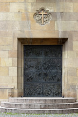 Fragment of an old cathedral facade with modern doors, Stuttgart