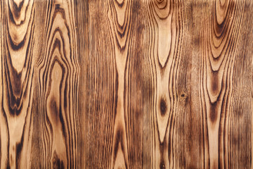 treated surface of burned planks of chestnut tree