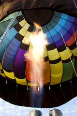 Flames from a burner inside a hot-air balloon envelop