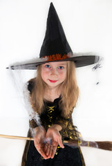 Girl posing in witch dress