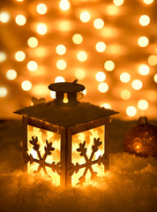 Christmas background with shining lantern, close-up.