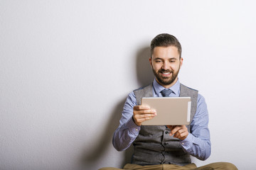 Hipster businessman with digital tablet