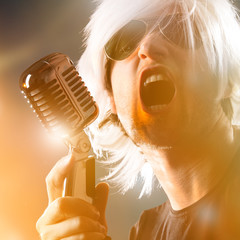 Rock singer screaming on the retro microphone