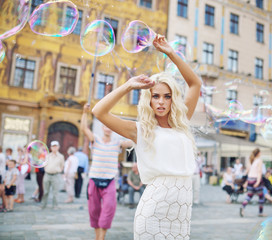 Attractive young lady posing with bubbles