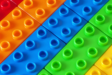 Toy background made of colored plastic bricks