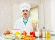 cook man  with cauliflower