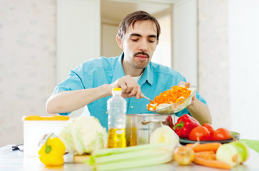 man doing  lunch with vegetables