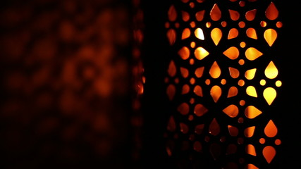 oriental lantern with candle in the darkness