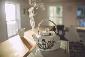 Steaming kettle and a cup
