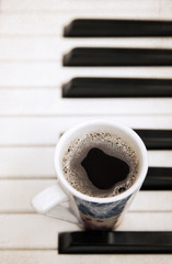 Artwork  in painting  style,  cup of coffee, piano