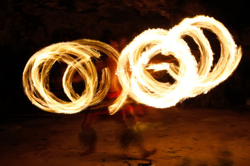 Fire show in famous Hina cave, blurred motion, Oholei beach, Ton