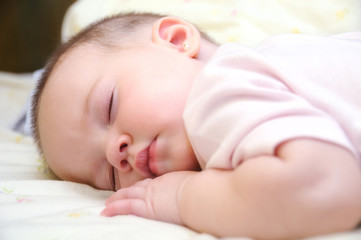baby sleeping on the bed