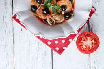 Fresh prawns with spaghetti, olives and parsley in tomato sauce