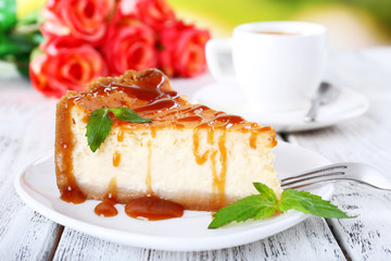 Cheese cake  in plate and tuft of roses