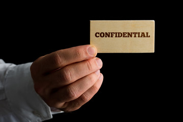 Man with a business card reading - Confidential