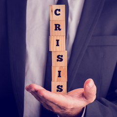 Man holding wooden cubes reading - Crisis